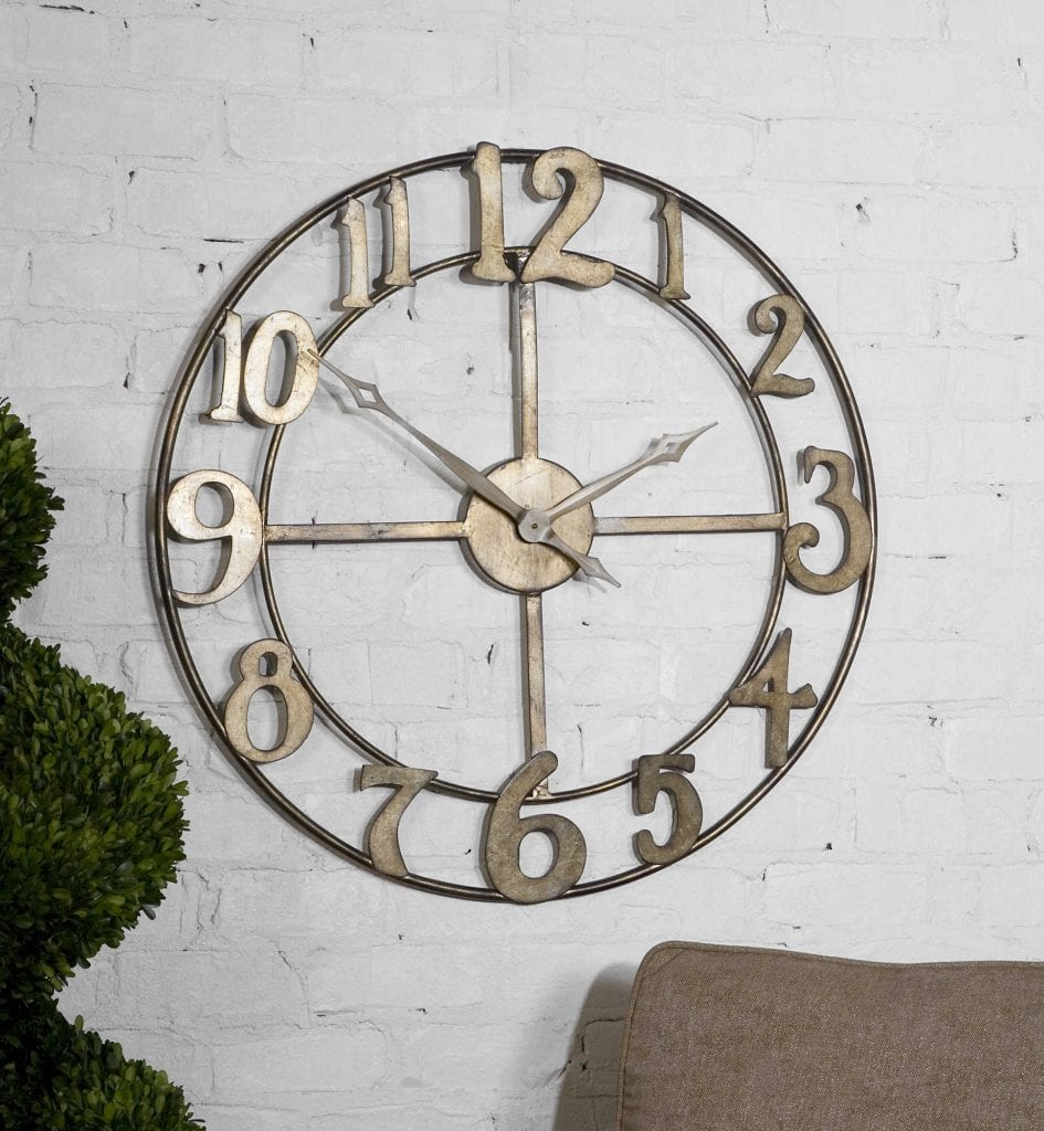 "Open design wall clock made of hand forged metal finished in antiqued silver leaf with burnished edges. Quartz movement ensures accurate timekeeping. Requires one ""C"" battery. 32"" Round"