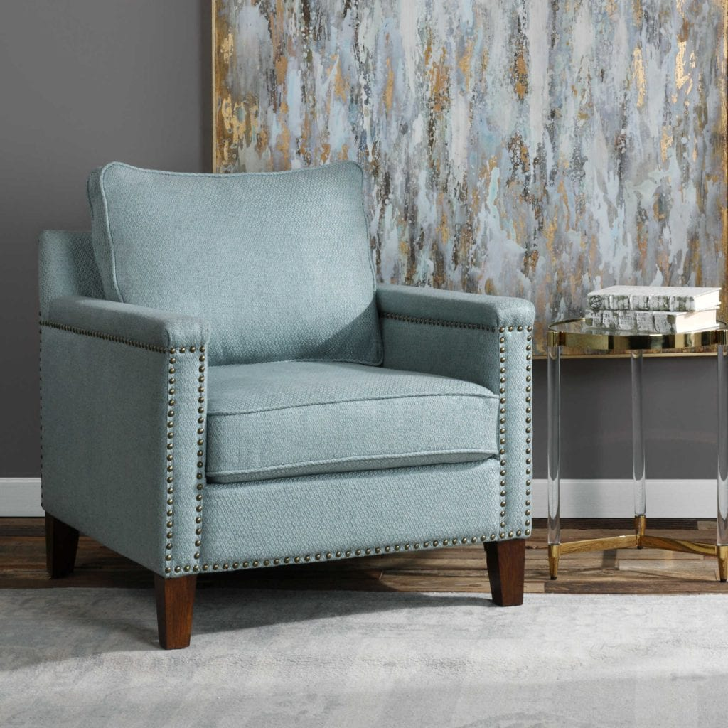 "Supportive comfort in a transitional club chair, with a subtle woven argyle pattern in light sea mist, accented with antique brass nail head trim on solid oak legs finished in dark walnut. Seat height is 17""."